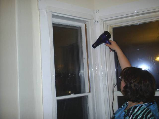 Using a hair dryer to shrink the plastic.